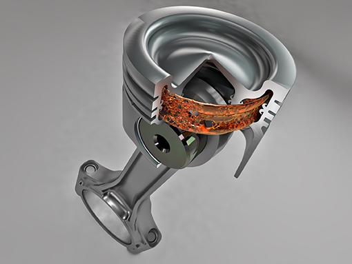Вид в разрезе поршня Monosteel® для дизельных двигателей от компании Federal-Mogul Powertrain, демонстрирующий герметичную камеру охлаждения EnviroKool™ в днище